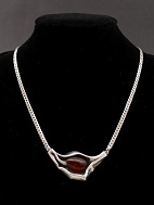 N E From Necklace 